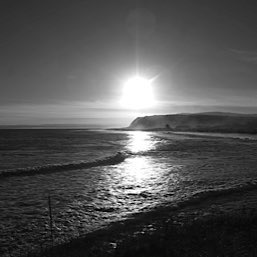 Setting winter sun over Shandwick Bay baech, a ten minute drive from The Old Manse Bed and Breakfast near Tain